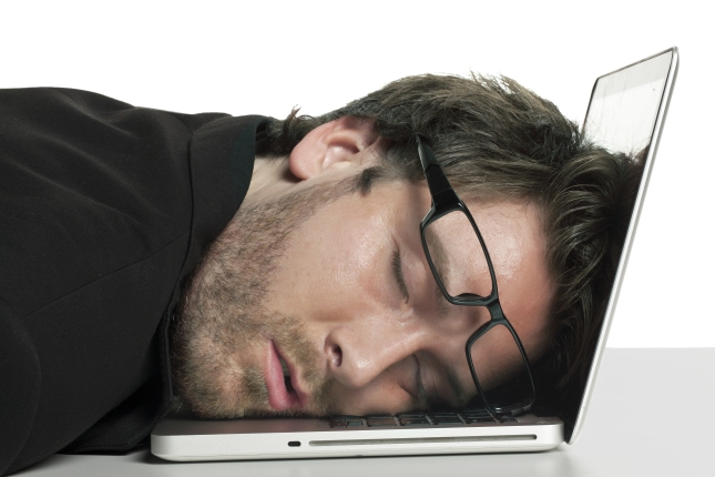 programmer asleep at laptop